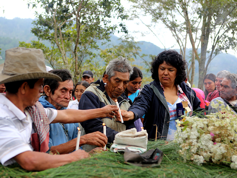 Cáceres gathers with colleagues and community members to honor and remember those killed in the two-year struggle against the Agua Zarca dam.