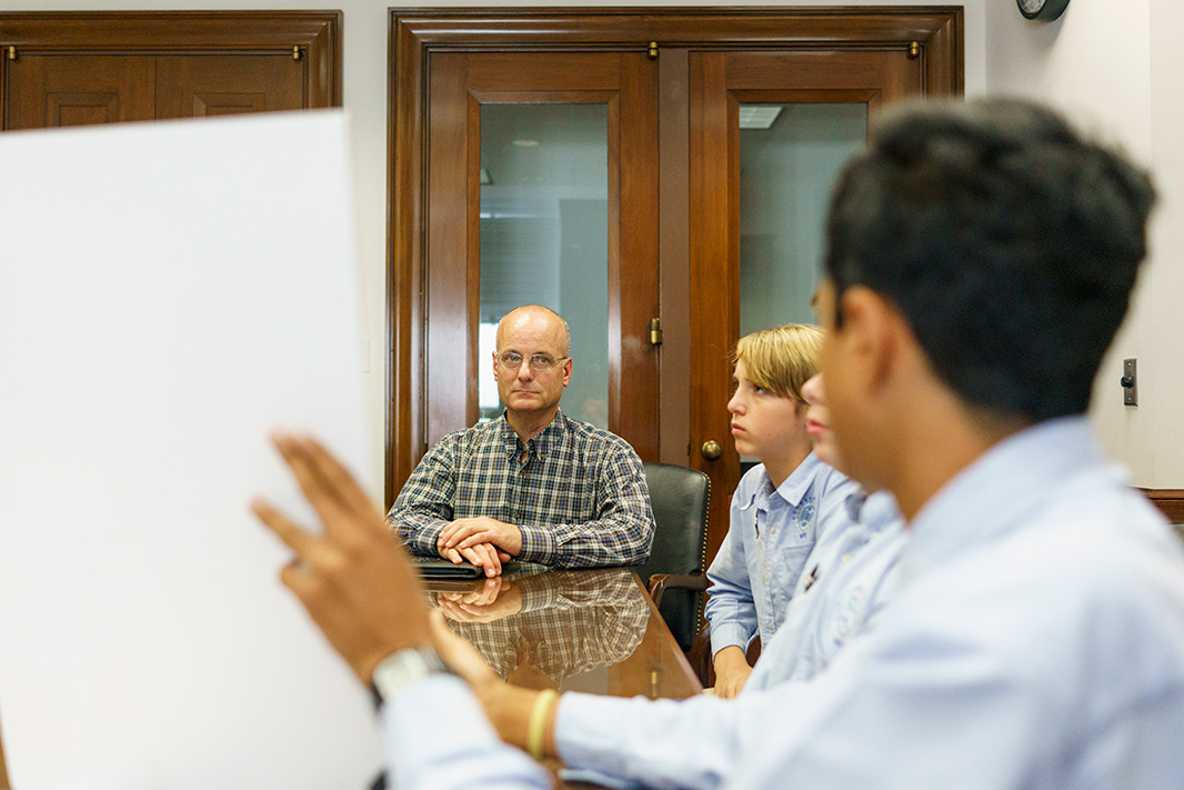 Hyperbolics member Rohit Rajagopalan (foreground) discussed industry support for banning lead wheel weights with EPW Committee staff member Tom Fox.