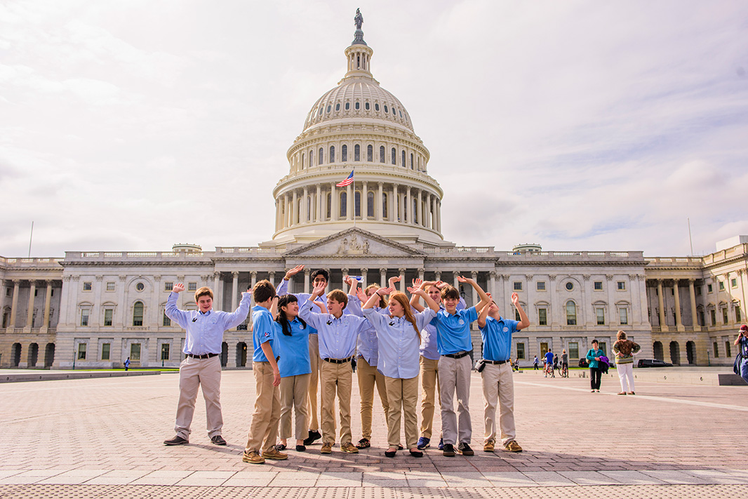 Members of the Hyperbolics mimed holding up the U.S. Capitol building.